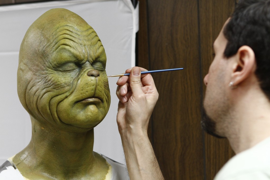 Tom preparing the Grinch for custom display